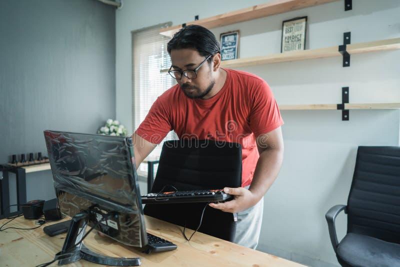 Portrait of technician fix a computer stock image
