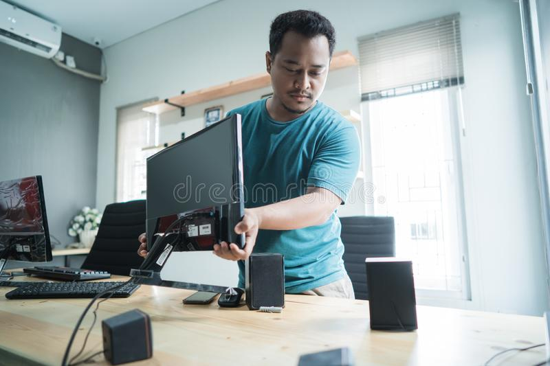 Portrait of technician fix a monitor royalty free stock image