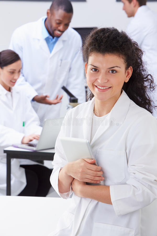Portrait Of Technician In Laboratory With Colleagues stock photo