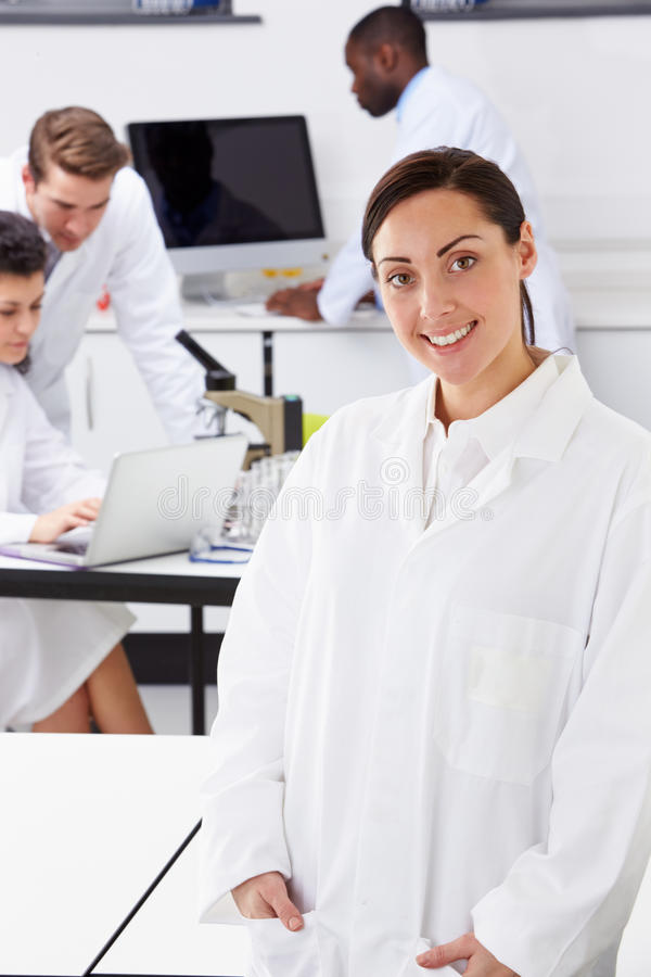 Portrait Of Technician In Laboratory With Colleagues stock images