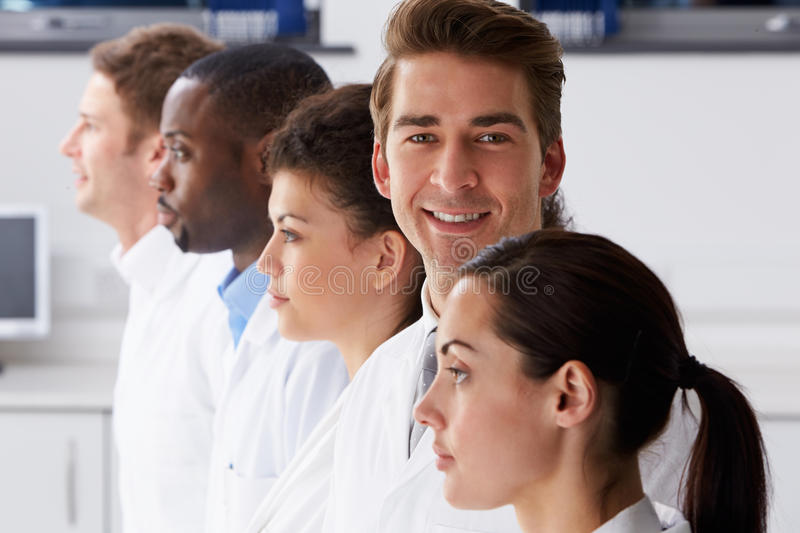 Portrait Of Technician In Laboratory With Colleagues stock photography