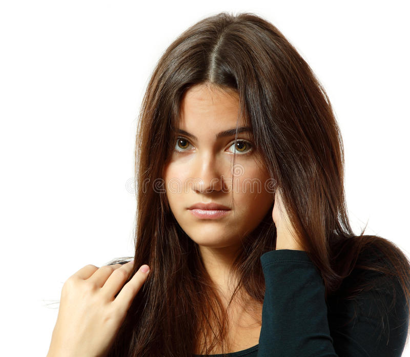 Portrait of teen girl in hard depression cried lonely. Isolated on white background royalty free stock photo