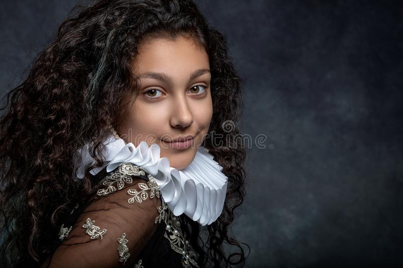 Portrait of a teen girl with long dark curly hair wearing a ruffled collar stock images