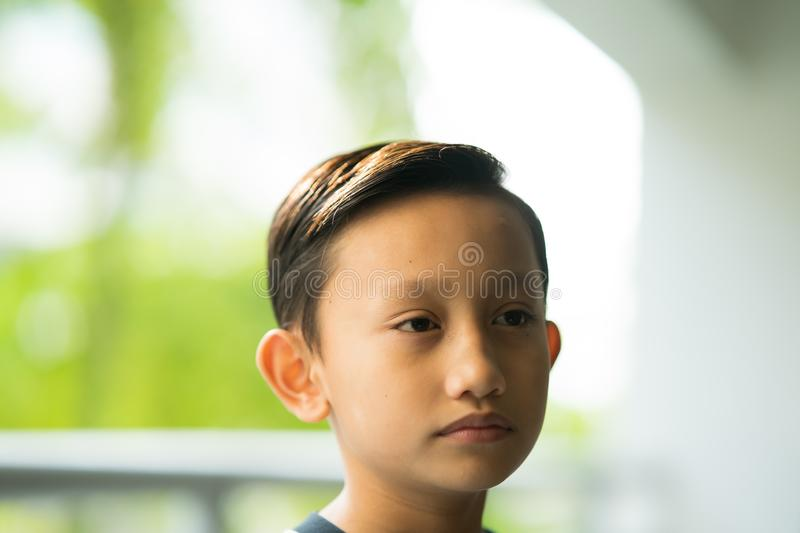 Portrait of a teenage Asian boy with emotion. stock image