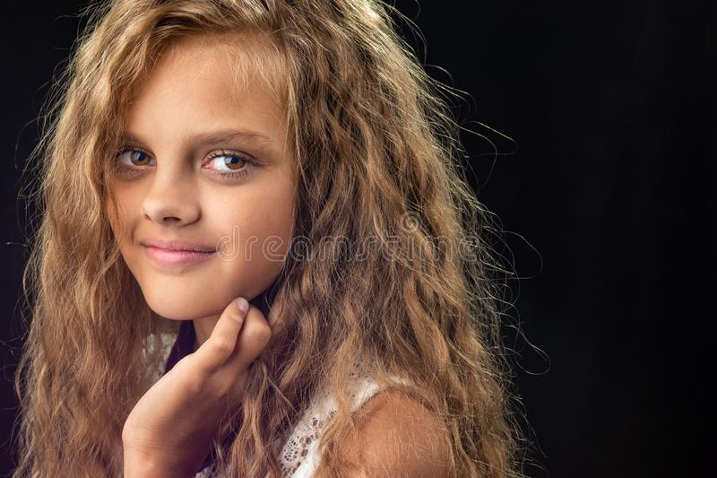 Portrait of a teenage girl with long curly hair royalty free stock photos