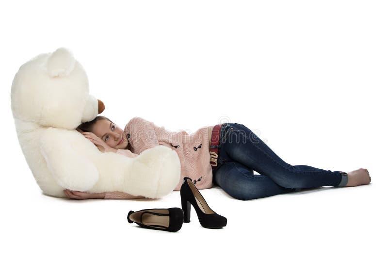 Portrait of teenage girl lying with teddy bear stock photo