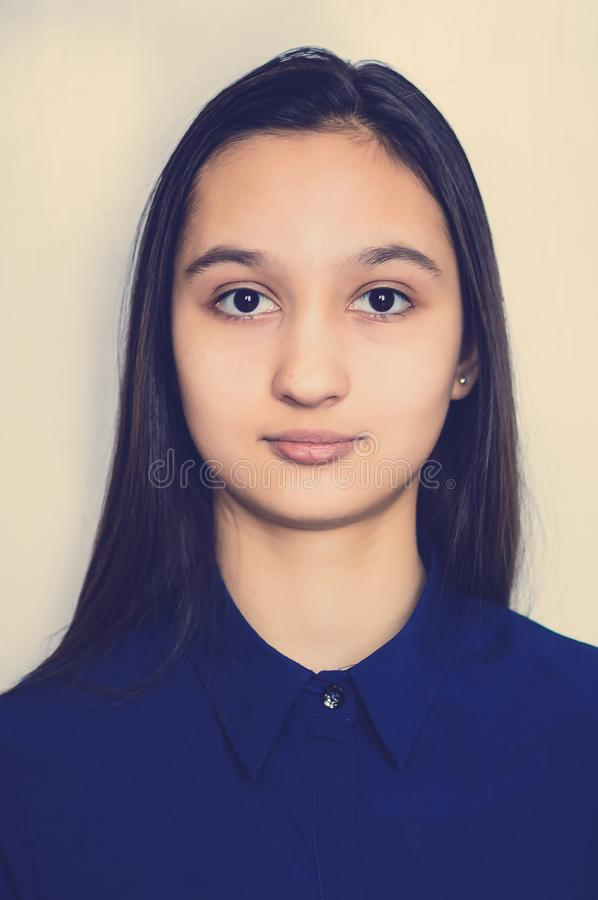 Portrait of a teenage girl on a neutral background. Toning instagram royalty free stock photos