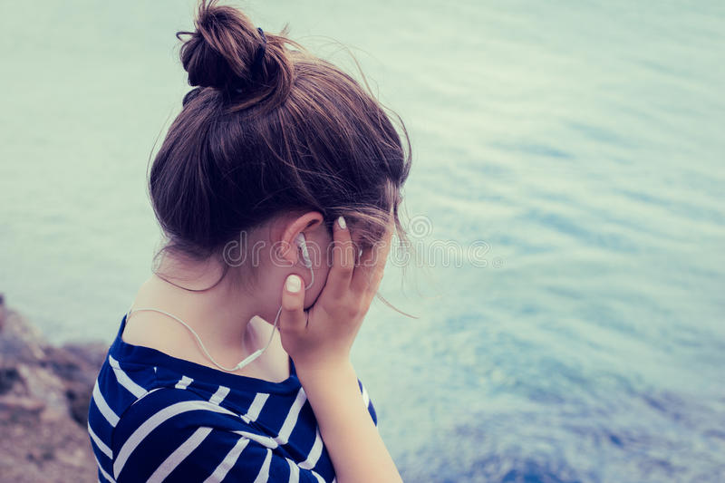 Portrait of a teenage girl in profile close up royalty free stock photo