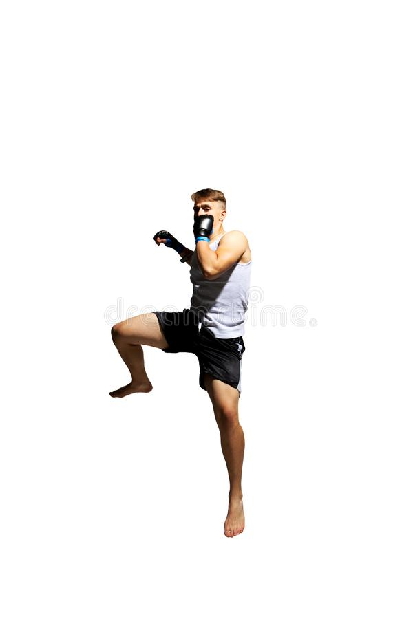 Teenager boxing in studio. The portrait of teenager boy training and boxing royalty free stock photography