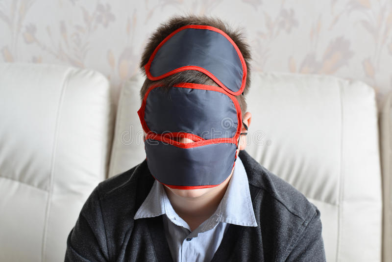 Portrait of teenager with few masks for sleeping on face royalty free stock images