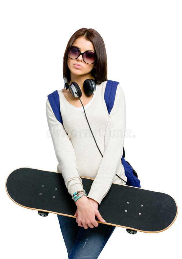 Portrait of teenager with skateboard, headphones and rucksack. Half-length portrait of teenager with skateboard wearing sunglasses, headphones and rucksack stock photos