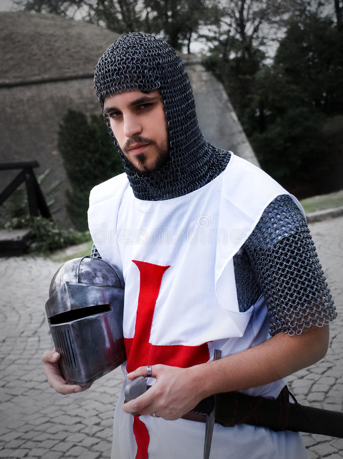 Portrait of a templar. Holding his helmet in nature background royalty free stock photography