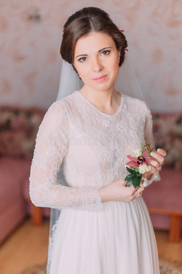 Portrait of tender girl in gown. Beautiful sensual young bride dressed for wedding ceremony stock image
