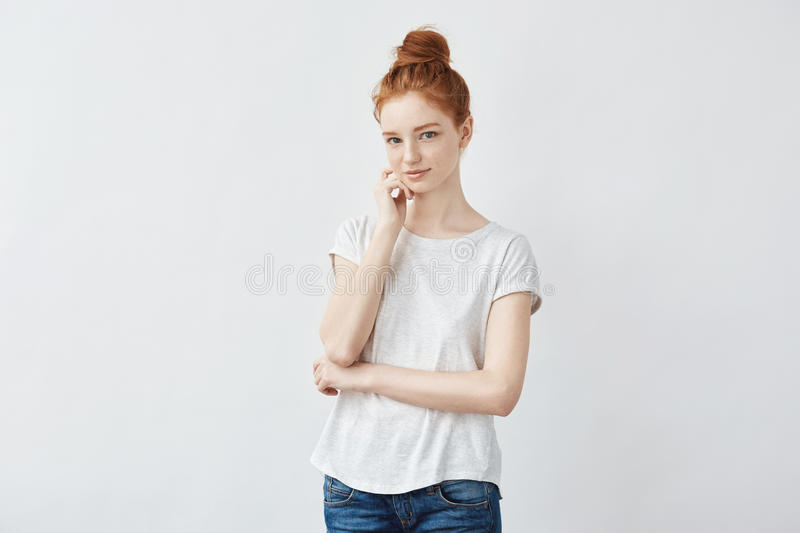 Portrait of tender redhead girl with freckled skin smiling. Portrait of young tender redhead girl with freckled skin smiling looking at camera. Copy space royalty free stock photography