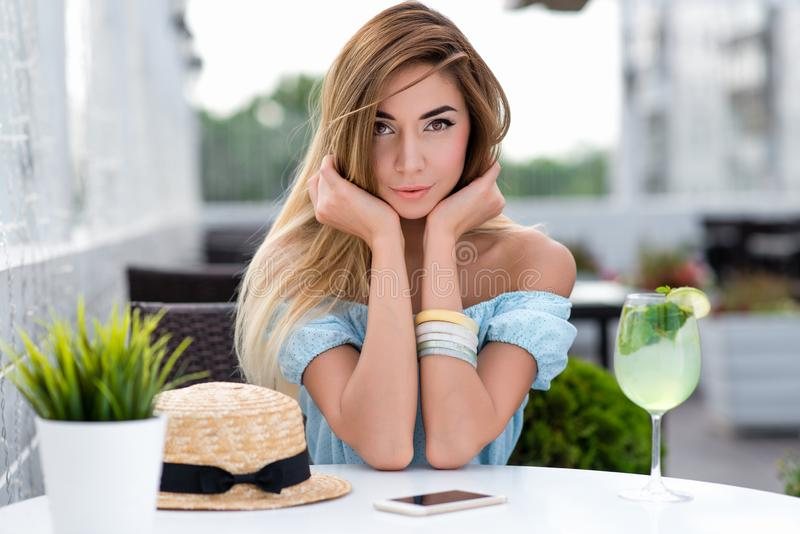 Portrait tender sensual beautiful woman summer cafe. Happy smiles anticipation communication, conversation. Long hair. Tanned skin everyday makeup positive royalty free stock photos