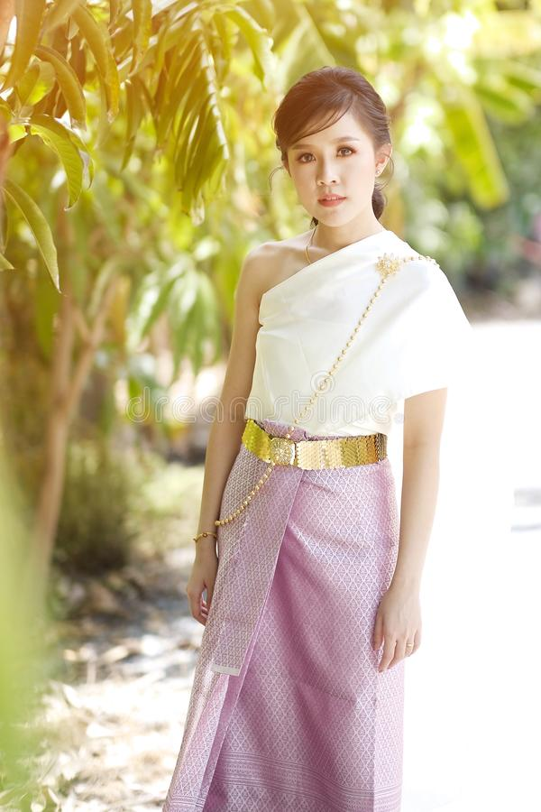 Portrait Thai women wearing Thai clothes in natural light. Portrait Thai woman wearing Thai clothes in natural light, dress, old, nature, traditional, asia royalty free stock image