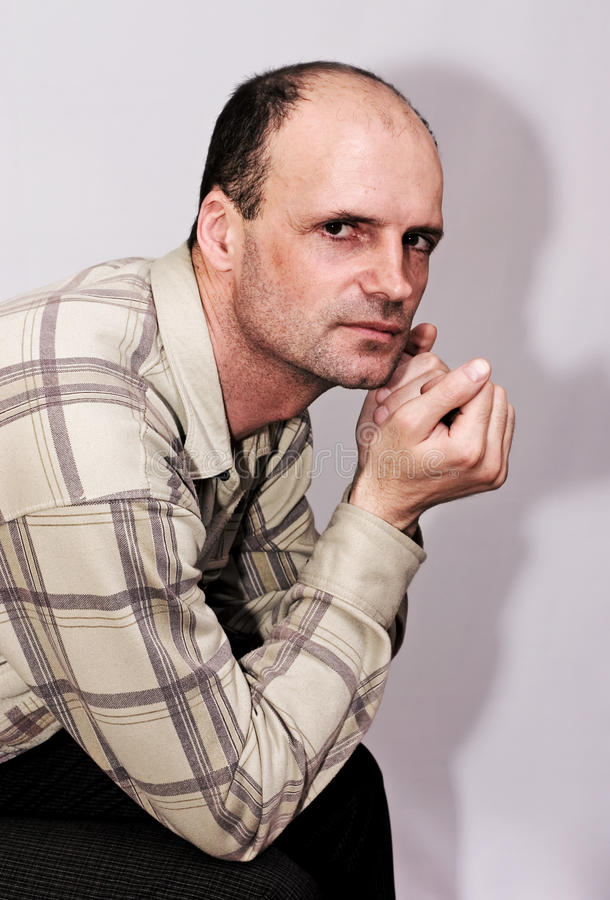 Download Portrait Of Thin Sitting Man Of Average Years Stock Photo - Image: 13670446