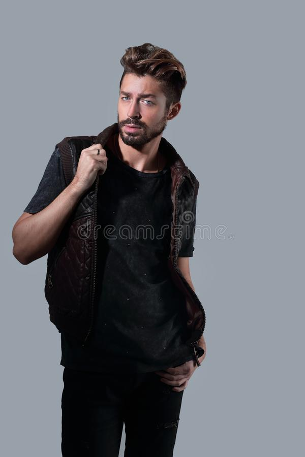 Portrait of thinking stylish young man touch his beard stock photo