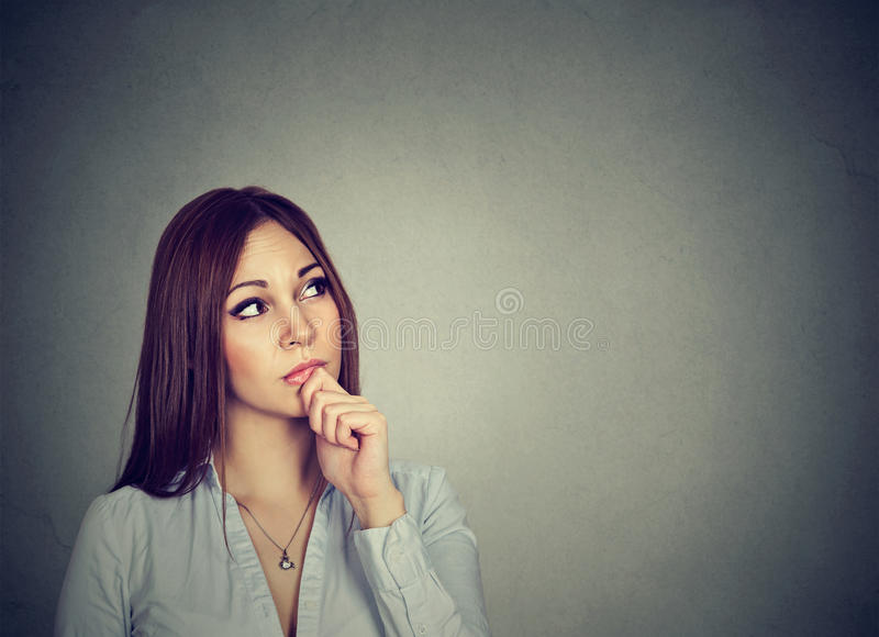 Portrait of a thinking woman stock photos