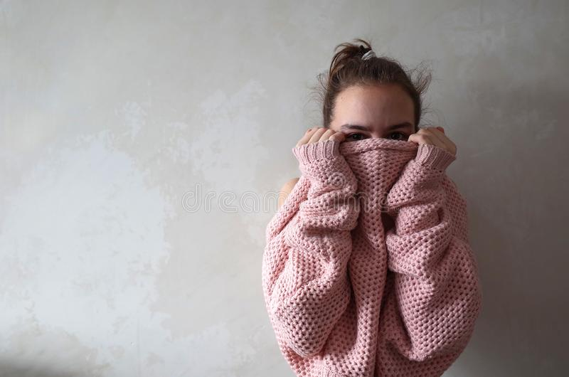 Teenage girl in pink knitted sweater royalty free stock images