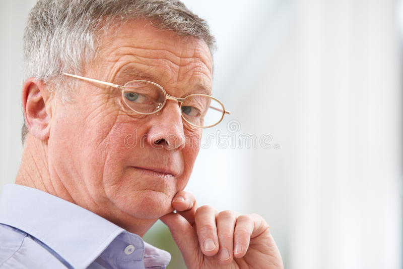 Portrait Of Thoughful Senior Man At Home royalty free stock photography