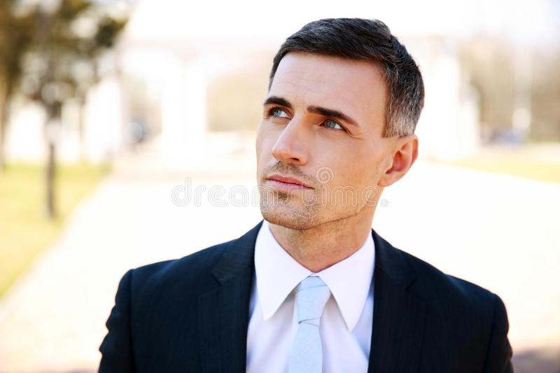 Portrait of a thoughtful businessman royalty free stock image