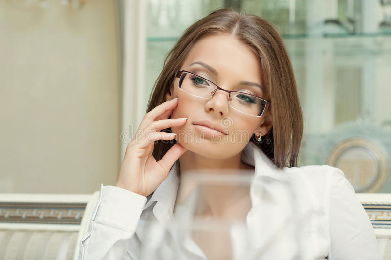 Portrait of thoughtful charming woman in glasses royalty free stock photo