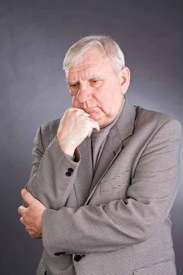 Portrait thoughtful elderly men. On grey background royalty free stock photos