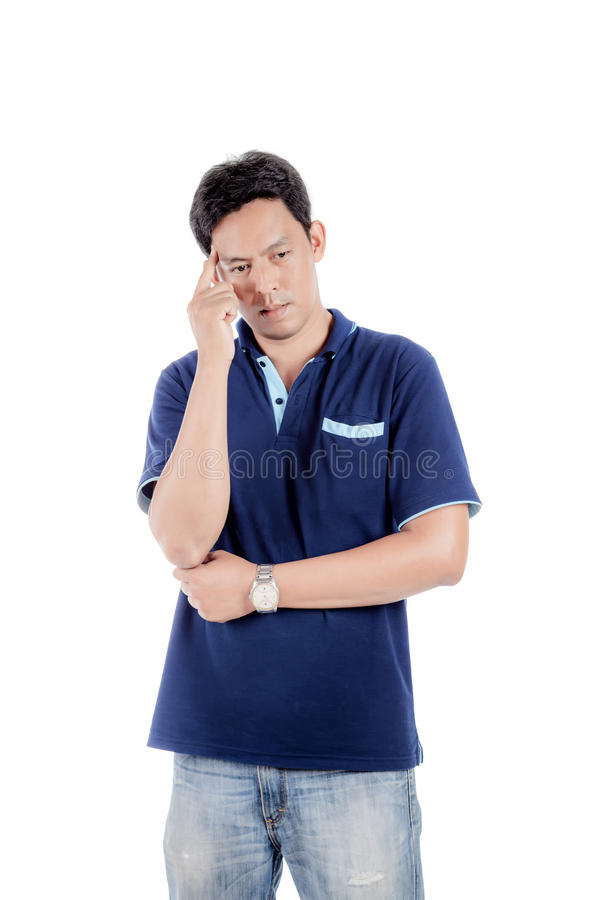 Portrait of the thoughtful handsome asian man looks up with hand near face. royalty free stock photos