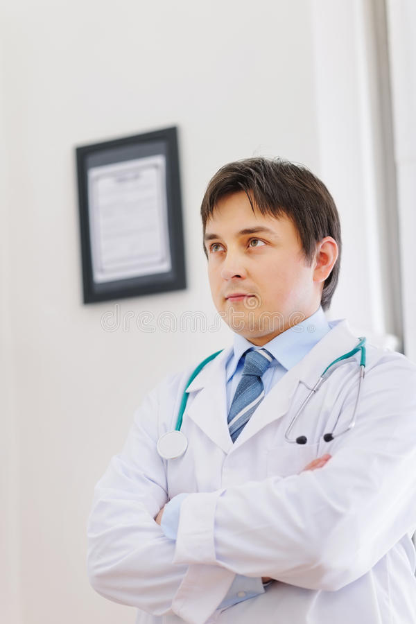 Portrait of thoughtful male medical doctor royalty free stock photography