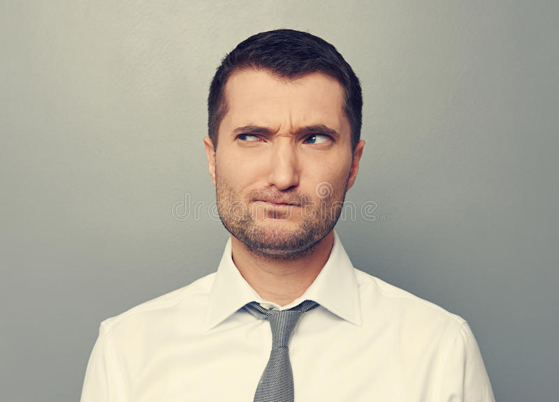Portrait of thoughtful man. Over grey background stock photography