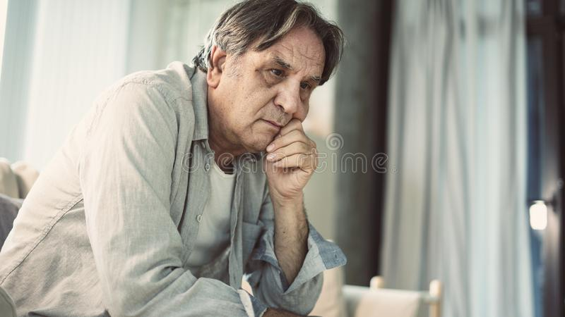 Portrait of thoughtful senior man royalty free stock photo