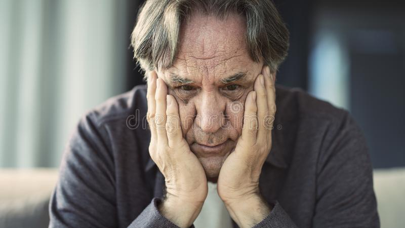 Portrait of thoughtful senior man stock images