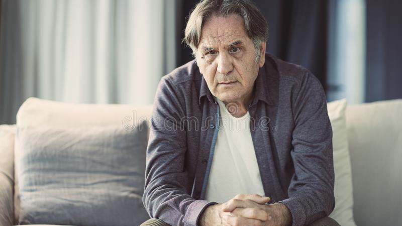 Portrait of thoughtful senior man stock image