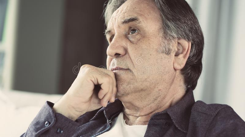 Portrait of thoughtful senior man royalty free stock photography