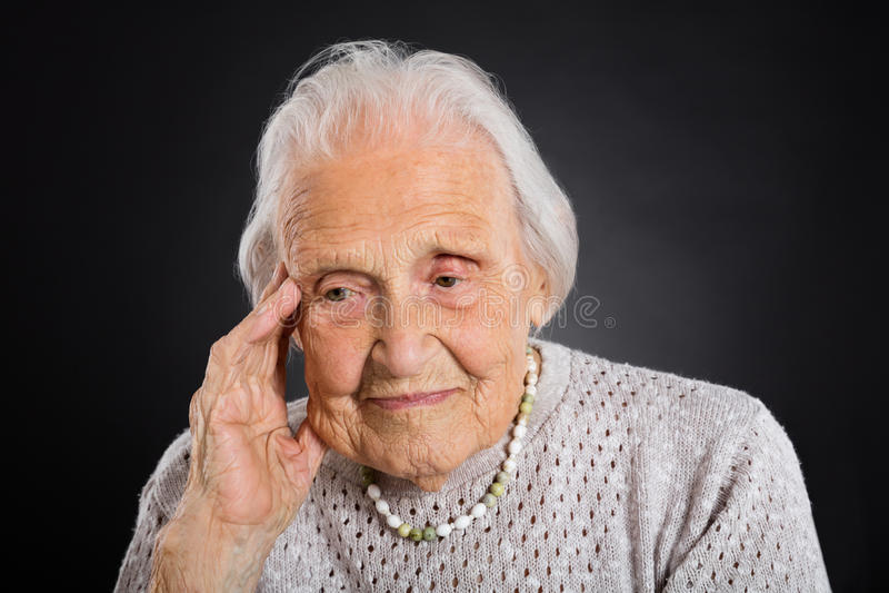 Portrait Of Thoughtful Senior Woman stock photos