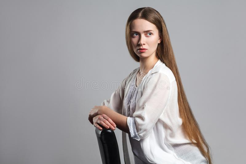 Portrait of thoughtful serious young model actor with long brown stock photo