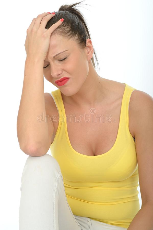 Worried Young Woman Sitting And Looking Up Stock Photo