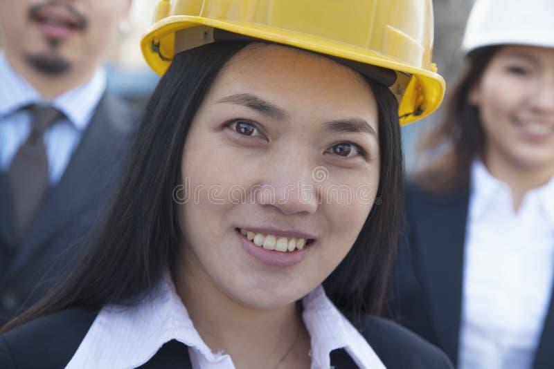 Portrait of three architects wearing hardhats, Beijing stock images