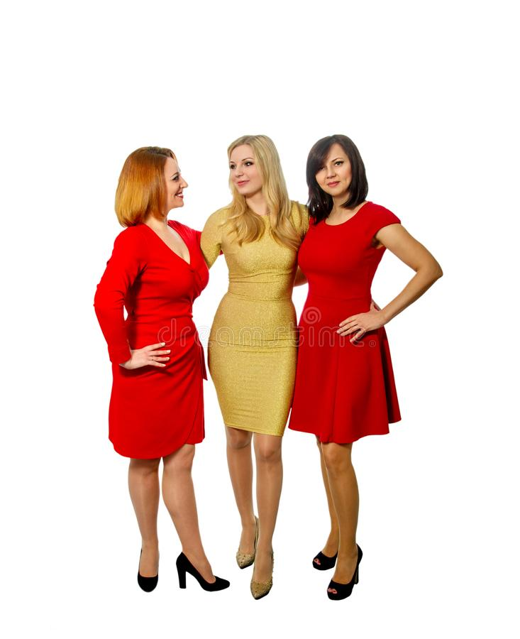 Three beautiful girlfriends in elegant dresses stock photo