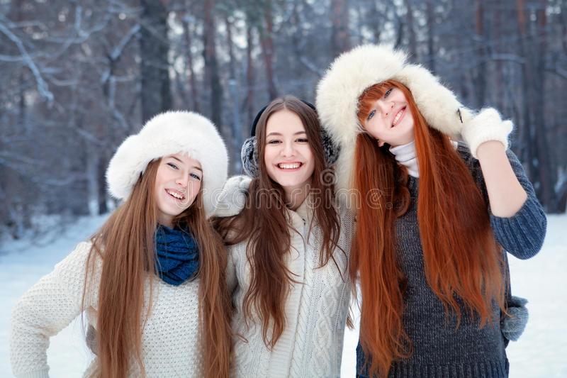 Portrait of three beautiful girls in winter park stock image