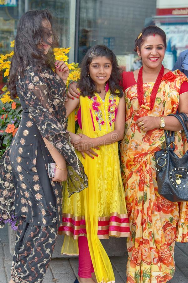 portrait of three brightly dressed beautiful indian women stock image