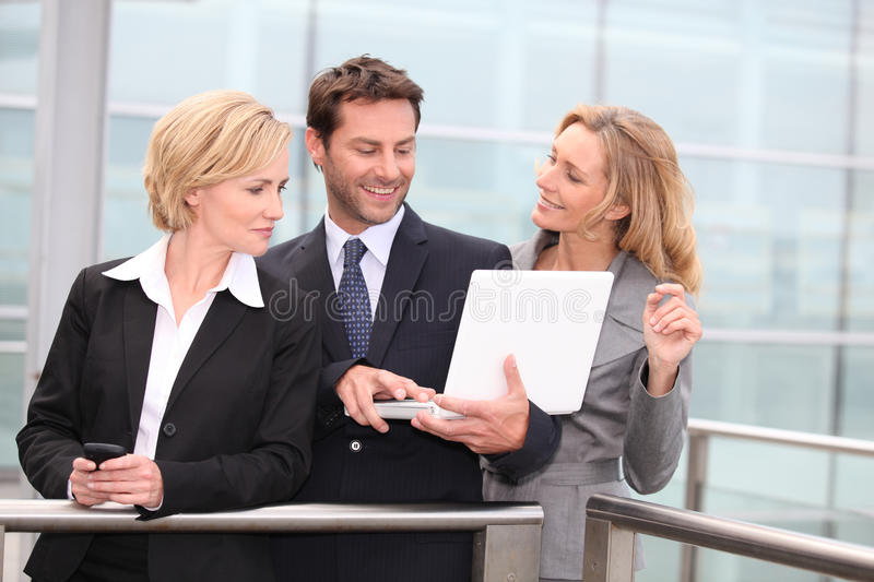 Portrait of three business people outdoors stock photos