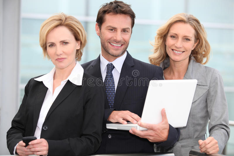 Portrait of three business people outdoors stock photo