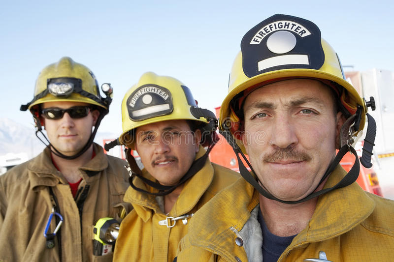 Portrait Of Three Fire Fighters royalty free stock photography