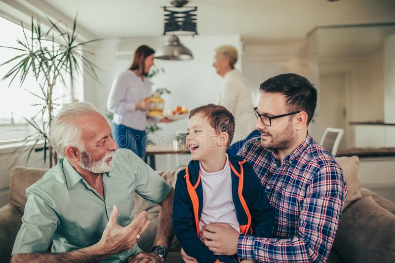 Three generation family spending time together at home royalty free stock photo