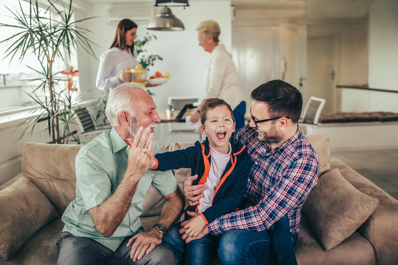 Three generation family spending time together at home royalty free stock photos
