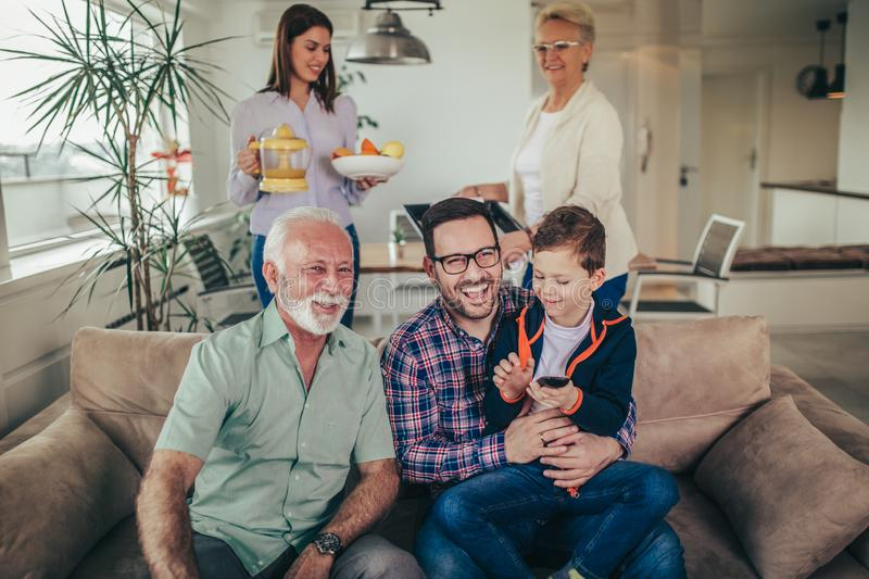 Three generation family spending time together at home royalty free stock image
