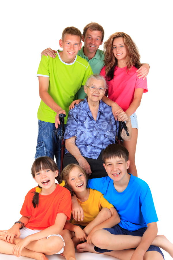 Portrait of three generations. Happy portrait of three generations including five children, three boys and two girls, their father and their Grandmother royalty free stock images