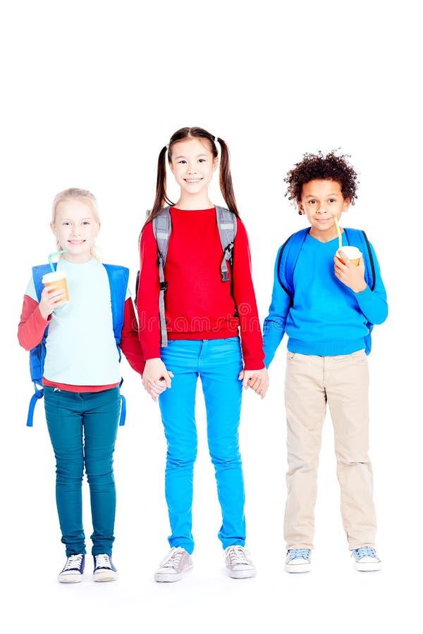 Happy three school friends stock photo